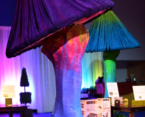 Oversized mushrooms created a magical setting in this Alice in Wonderland themed auction area.