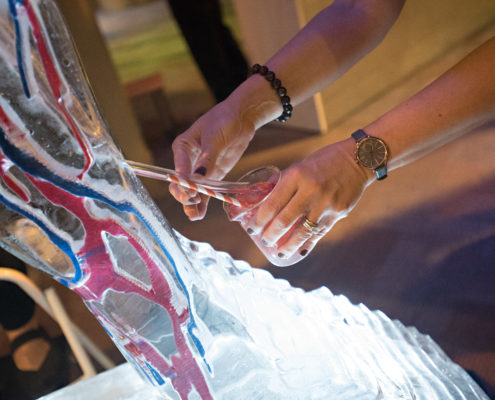 Guests helped themselves to a drink from a body ice luge. The liquid poured from the bodies' veins.