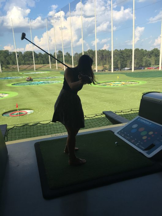 Hallett shows us how its done at Top Golf.