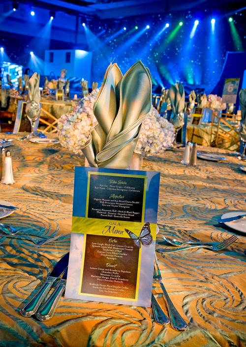 Custom dinner menu displayed at each place setting to enhance the event theme – A Brand New Day.