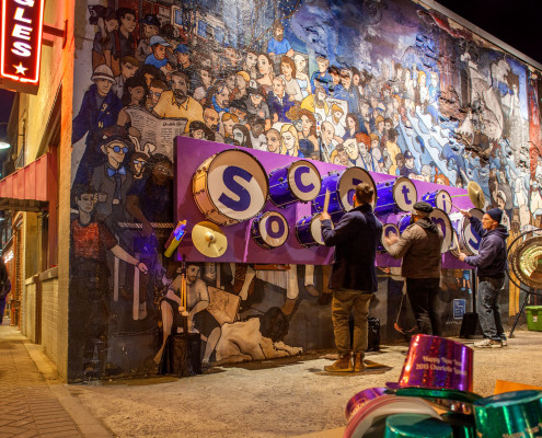 A custom drum wall was created in an eclectic neighborhood of Charlotte encouraging people to find their rhythm. A professional drummer was close by to give a quick lesson.