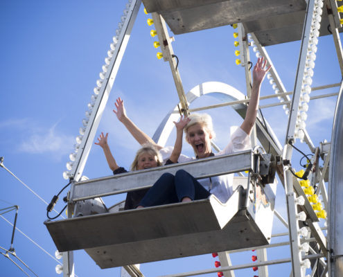 Family-friendly activities including a ferris wheel took over a parking lot for a corporation's outdoor festival.