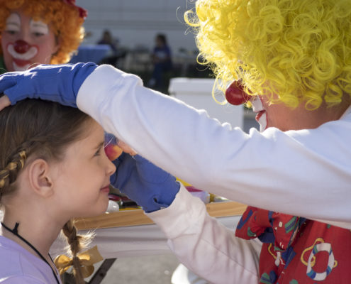 Children enjoyed face painting along with other activities at a family-friendly outdoor festival.