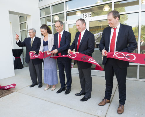 The cutting of a branded ribbon marked the grand opening of a North American headquarters.