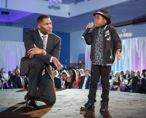 Michael Strahan and Young Dylan co-hosted a fundraising gala.