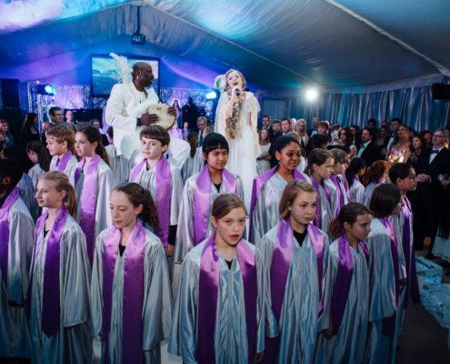 "A children's choir of 100 along with Lexi Walker sang Disney's Frozen ""Let It Go"" at an annual non-profit gala."